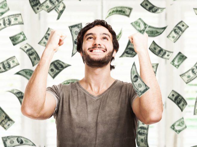 Man-in-rain-of-money-1024x682