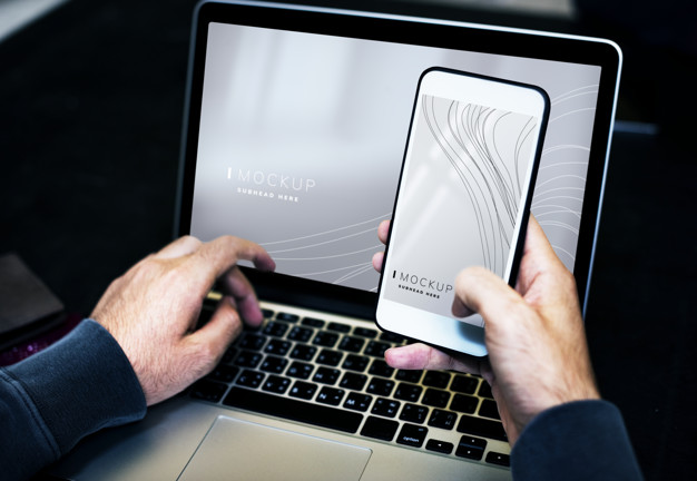 Businessman using a laptop and a mobile phone mockup